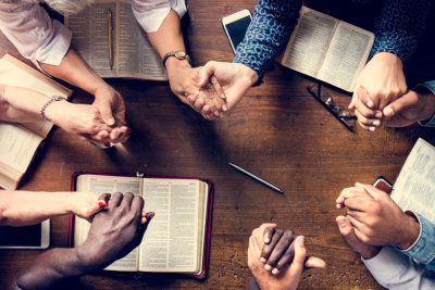 a group of people doing bible study